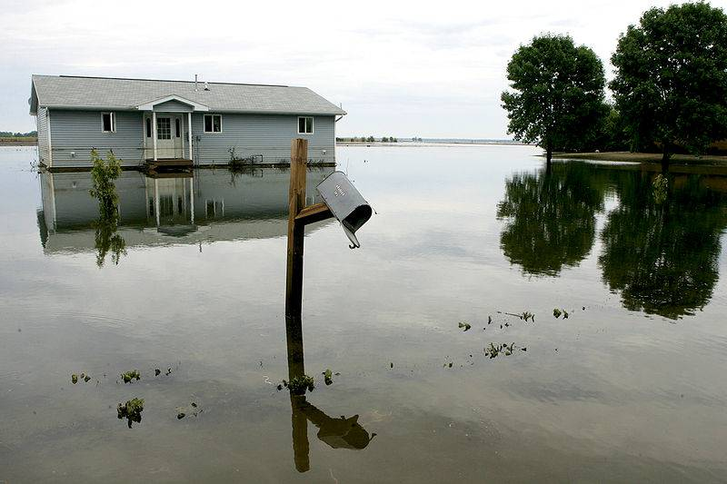 House submerged in flood