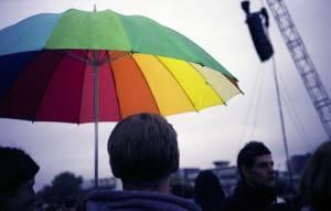 Man holding a colorful umbrella