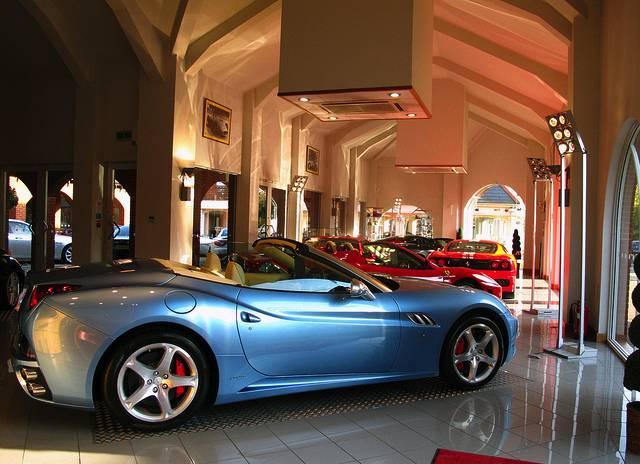 A modern light blue sports car in a car dealership