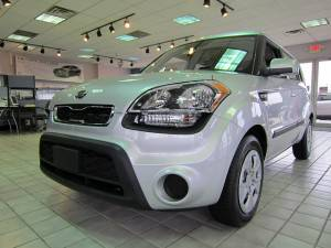 a white Kia Soul parjed inside a showroom