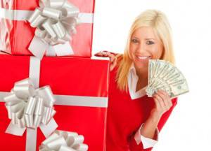 Woman showing money with a few gifts