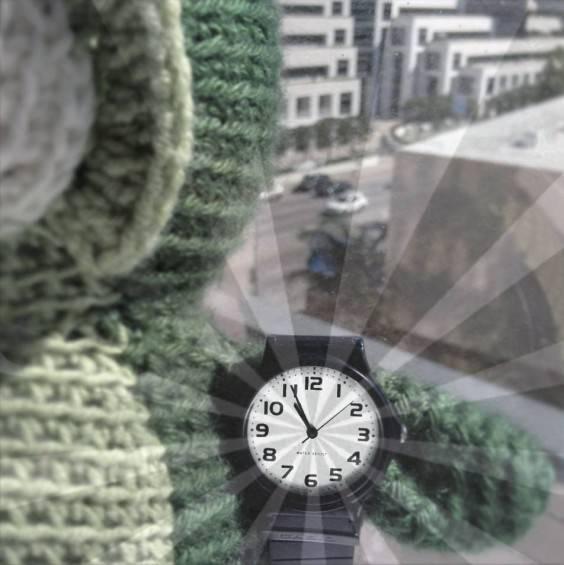 Owlbert showing a wrist watch