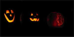 Jack-o-lanterns lit up in the dark