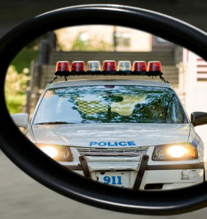 Rear mirror view of police car