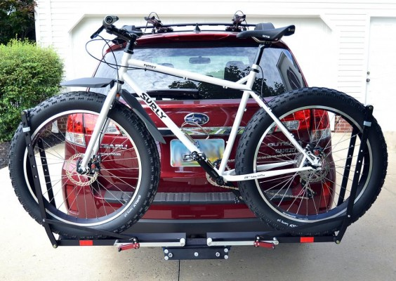 Bike mounted on rack behind SUV