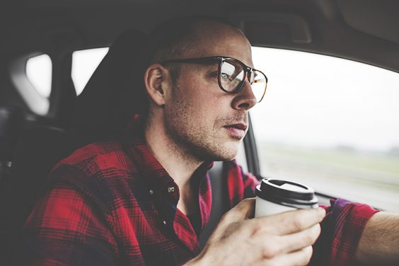 driver with coffee cup