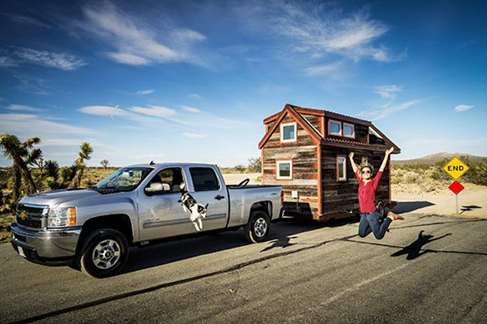Truck pulling a tiny house