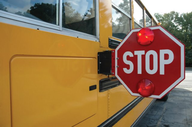 Yellow school bus with the stop sign engaged