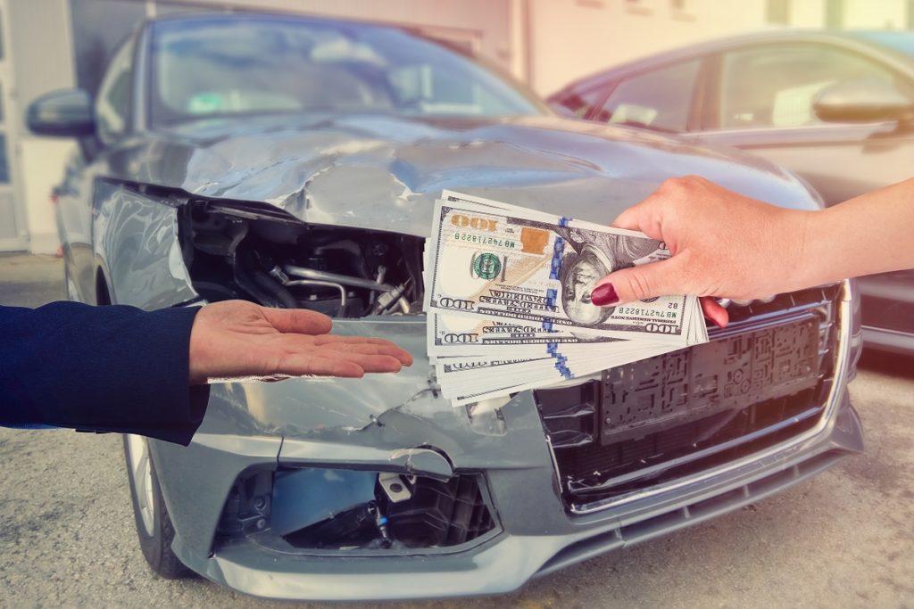 customer pays money dollars for car repair.