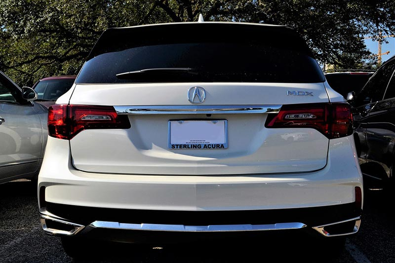 White Acura MDX without a license plate